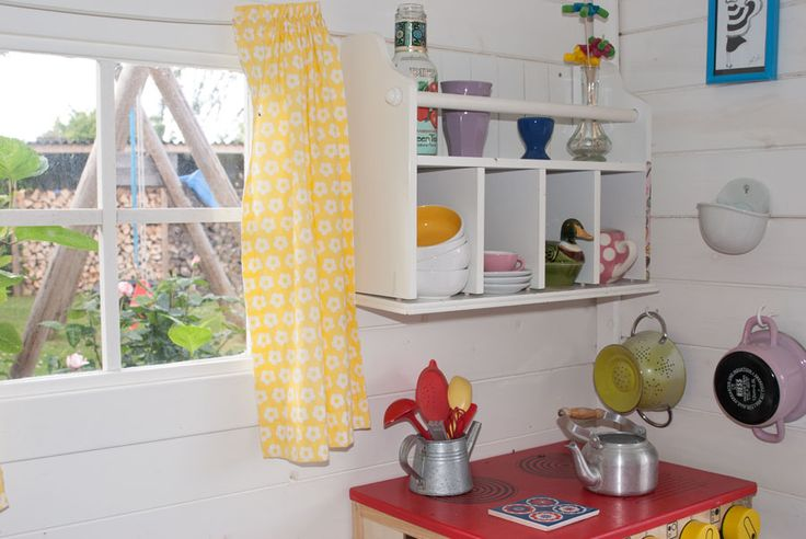 Inside of our playhouse. A Little kitchen to play with. See more at www.evabyeva.dk