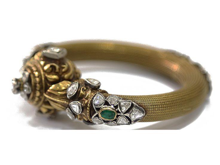 Nakshi gold kada studded with uncut diamonds and emeralds, from Karni Jewellers.