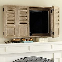 Shutter TV Wall Cabinet-I would hack this with folding barn door style instead of shutters.