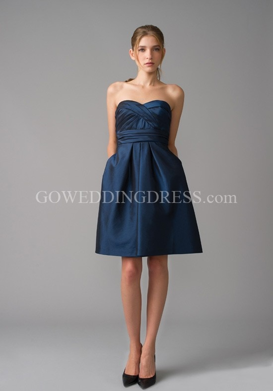 @Joanna Drabik . I love navy too! I guess find the dress( or dresses) I like the best for my bridesmaids and see if they come in a pretty blue or navy or gray! hard decision!