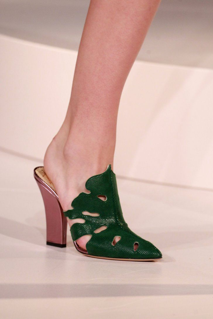 Charlotte Olympia's Spring '17 Collection Will Transport You to the Tropics  A pair of mules fashioned after the trendy Swiss cheese!