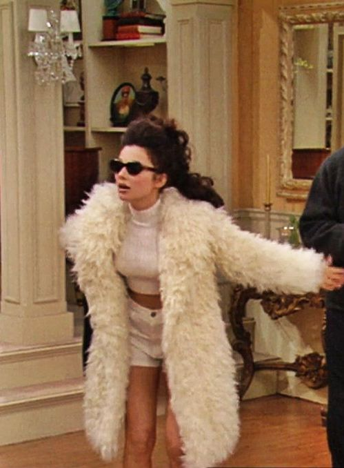 Fran Drescher's 90s Style White Furry Jacket and Short Shorts Outfit, As Seen on The Nanny // More Style Inspiration Ideas To Steal from The Nanny: (http://www.racked.com/2015/10/22/9586048/the-nanny-fran-drescher-style)