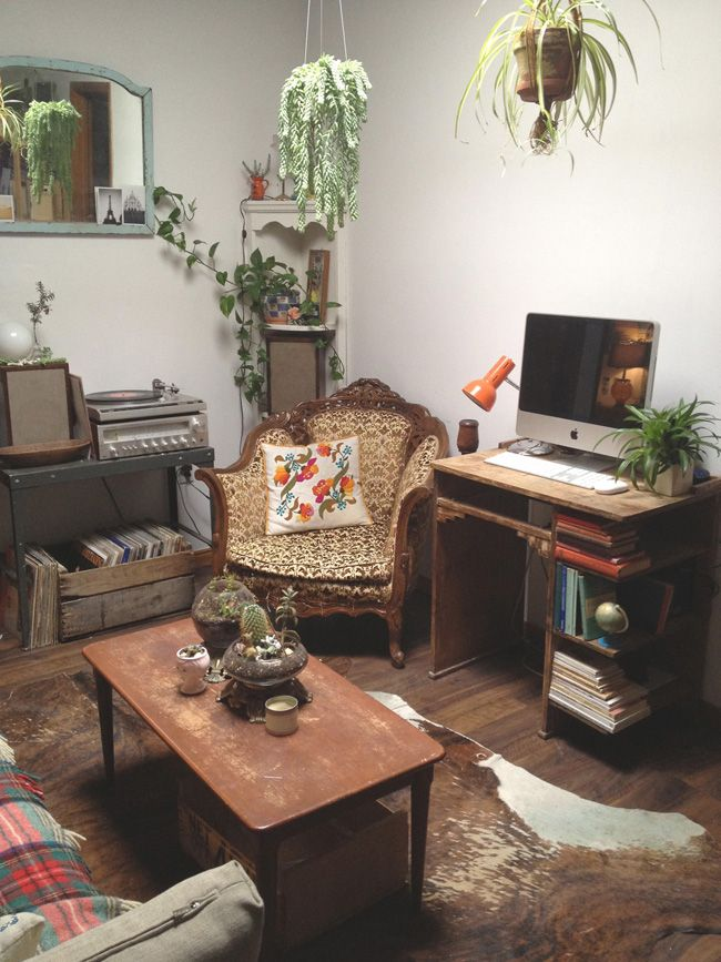 Juliana Neufeld, Toronto.  This is basically my idea idea of the perfect living room, with plants, retro vintage, cowhide rug, computer monitor, plaid throw blankets, and a record player.  Perfect!