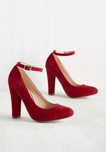 As your favorite web zine's new nightlife journalist, your first task is to review a salsa club opening, and you take these red heels along for the ride! Mixing business and pleasure with their timeless ankle straps and tapered pumps, these velvet kicks dance their way to a front-page feature.