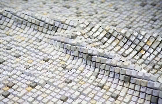 World's Longest Keyboard by Jean Shin.  The design includes more than 22,528 computers and 192 custom keycap which are attached with fabric, a custom keyboard and software assets as well as interactive video projection and painted aluminum frames.  #colorevolution