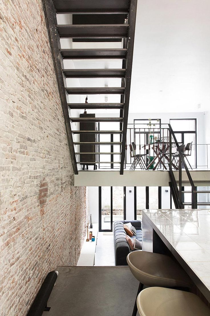 Industrial staircase with brick wall. Design by BNLA architects, photography by Jansje Klazinga.