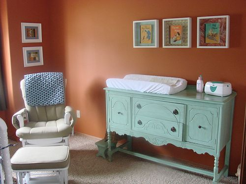 Perfect for a nursery. Use an antique buffet table as a changing table.