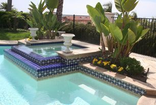 Mediterranean Hot Tub with exterior stone floors, Raised beds, Fence