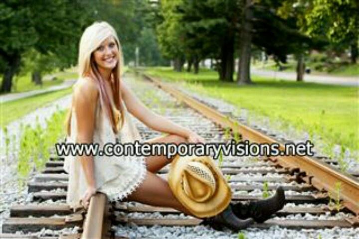 Train track senior picture.