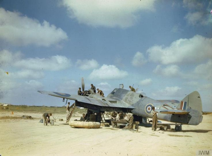 A Royal Air Force Bristol Beaufighter Aircraft (No 252 Squadron?) being serviced in the North West African Desert. Libya May 1943