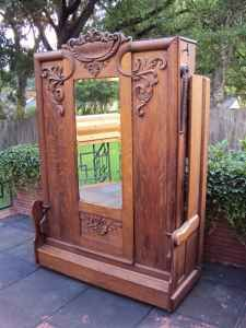 antique fold-down bed that looks like an armoire when closed. Amazing!  we used to call it a 'murphy' bed....