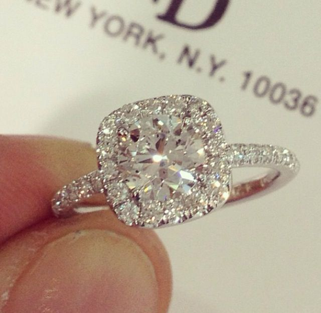 Round center diamond with a cushion halo.
