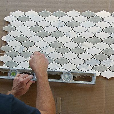 Installing Mosaic Tile - Lay the sheets of mosaic tile ...