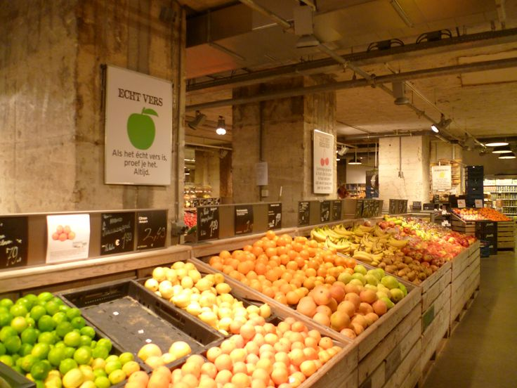 In this organic supermarket they have made a point of making the fruit and the product the main focus meaning a very minimal industrial feel is given off from the actual design of the building.  Organic Supermarket in Amsterdam