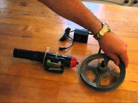 Inexpensive electric motor for Halloween animated scenes. Cordless screwdriver with dead batteries.