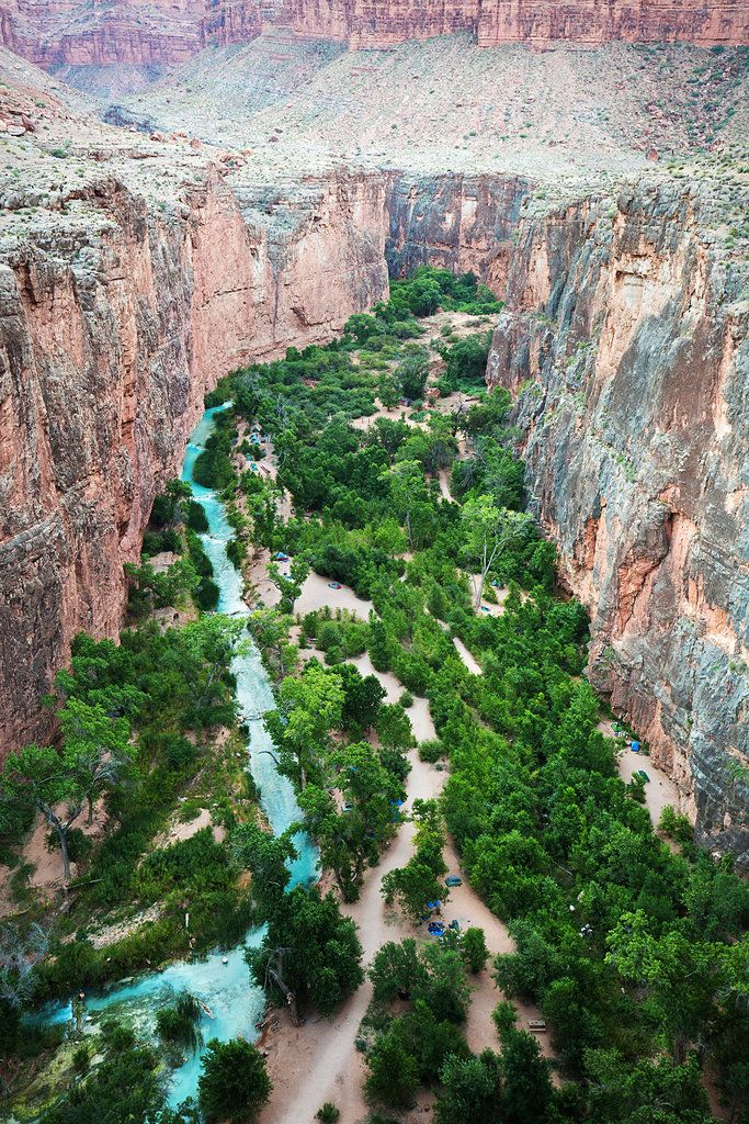 Havasu Falls are at the bottom of a narrow gorge near the southwest corner of the Grand Canyon National Park.