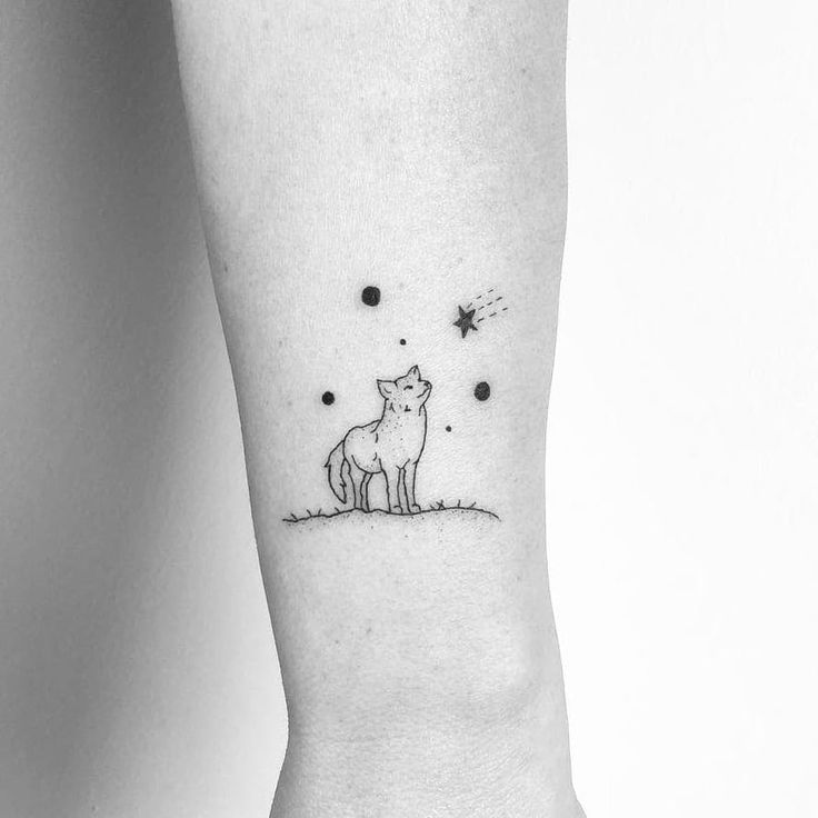 Little Wolf tattoo by Mimi Mine #MimiMine #fineline #linework #dotwork #small #minimal #wolf #dog #coyote #fox #animal #nature #stars #galaxy #tattoooftheday