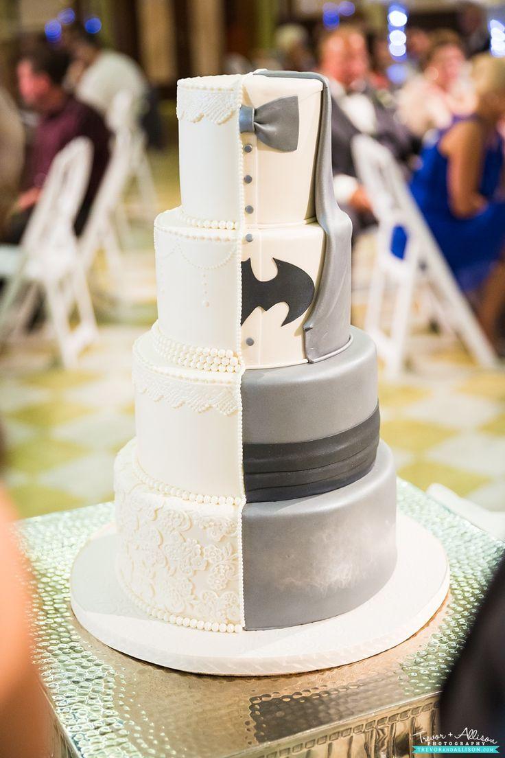 Classic ivory cake meets Batman! Amazing idea for a Bride and Groom split wedding cake! - haha that's actually kinda cute