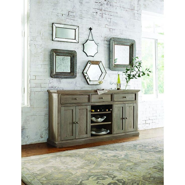With 3-drawers, 2 cabinets and 3 open shelves, our Aldridge Sideboard is a dining room buffet with plenty of storage space. Fill it with everything you need. From entertaining, dishes and serve ware to linens and other dining essentials. With slim molding on the drawer fronts, recessed-panel doors, angled top molding and fluted foot molding, this sideboard offers striking farmhouse style.