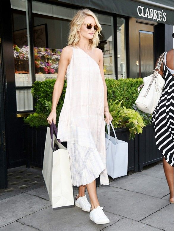 Rosie Huntington-Whiteley wears a plaid Stella McCartney off-the-shoulder dress with Isabel Marant white sneakers