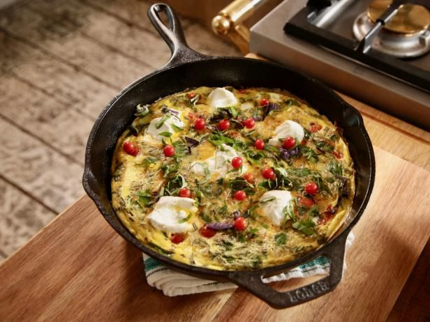 Get Herby Greens and Goat Cheese Frittata Recipe from Food Network.  Made this and LOVED it!  Soo easy!