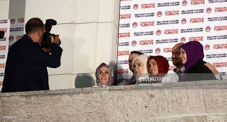 Sumeyye Erdogan (3rd R), Esra Albayrak (2nd L) daughter of Recep Tayyip Erdogan (not seen), Turkish Presidential election winner according to unofficial results, and his wife Emine Erdogan (3rd L), his son Bilal Erdogan (2nd R), son in law Berat Albayrak (2nd L) and his daughter in law Reyyan Erdogan (R) pose ahead of a speech of Erdogan at the ruling AK Party's headquarters in Ankara, Turkey on August 10, 2014.