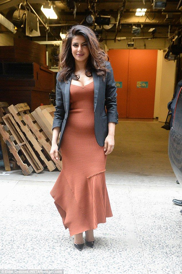 Stylish lady: Priyanka Chopra was spotted outside the New York studio for her Live With Kelly interview where she donned a fancy light dress with a black jacket