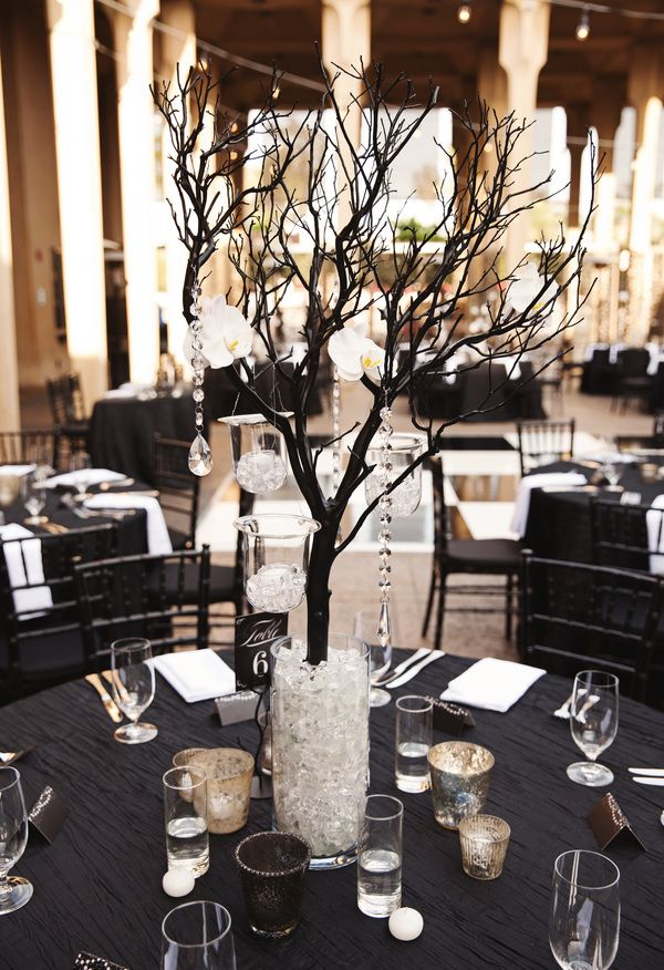 Chic black tablecloths, black branches, dripping crystals // Aaron Huniu Photography