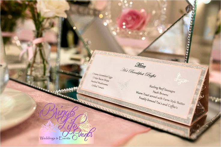 Pink, white and silver menu with silver heat embossed butterfly. Elegant with diamonds