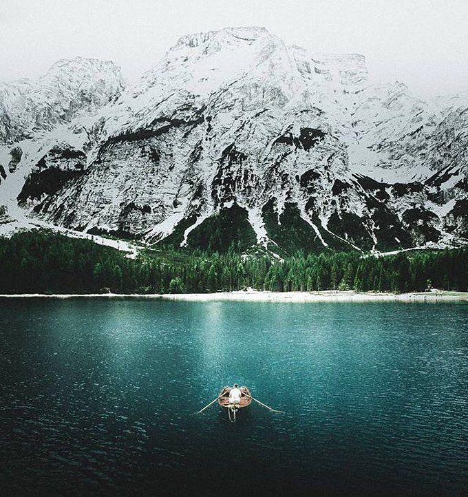 """via. @michaleksadowski  """"According to legend Lake Braies is the gate to the underworld kingdom of Fanes. My favourite spot in all of the Dolomites / South Tirol. Paddling a boat in front of the Mountains like this is really hard to beat.""""  Zobacz więcej podróżniczych inspiracji na: http://ift.tt/2k1V00E  Polub nas na fb: http://ift.tt/2qiHjxm Poznaj nas na Twitterze: http://twitter.com/wagabundaclub - Polub nasz profil i oznacz nas na zdjęciu @wagabundaclub a podamy Twoje zdjęcie dalej :)…"""