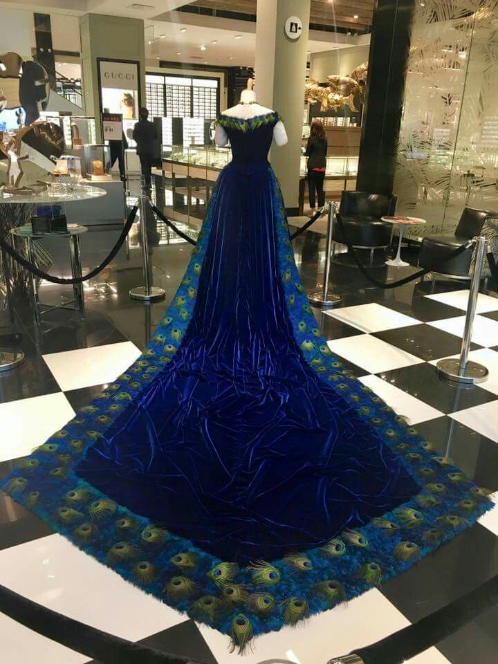 Iris Viacrucis presents the Queen Kapiolani Peacock gown, the fourth installment to the Ali'i Gown Reproduction project. Queen Kapiolani wore the original to the golden jubillee of Queen Victoria of England in 1887.