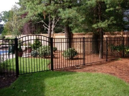images of landscaping by a black metal fence - Google Search