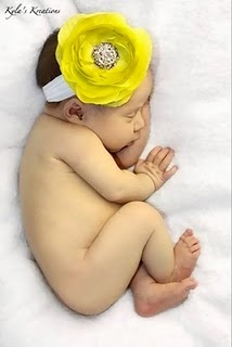 If it's a girl: Neon yellow flower hair band. Love.