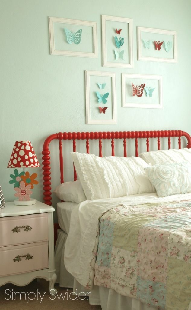 Beautiful blue, pink , and red girl's room. Love the shabby chic quilt and butterfly wall art!