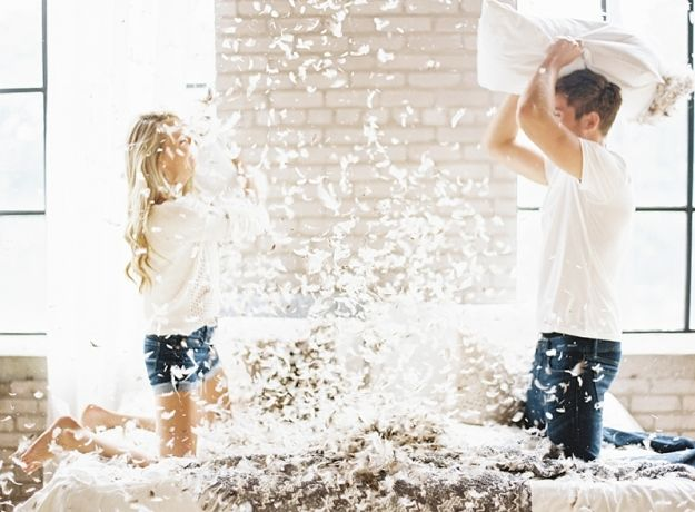 Pillow fight engagements shoot, emily jane photography, engagement on bed, grand rapids photographer