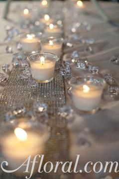 Inexpensive Extras- Wedding Decor, candles, diamond reflection runner, clear diamond vase fillers #WeddingDecorations #BudgetWedding shop wedding flowers and wedding decorations www.afloral.com