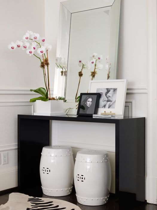 Black and white drama, placement of white garden stools under console