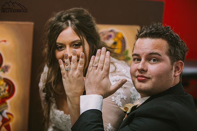 Bride and Groom show off their wedding rings on their wedding day