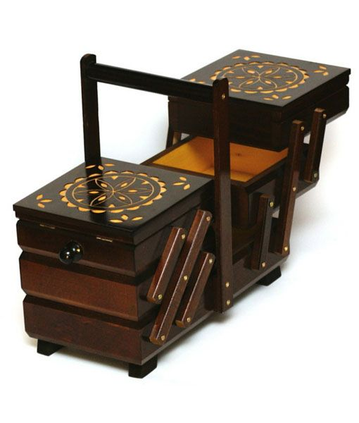 This is a dark stained handmade wooden sewing box. The top has attractive engraved patterns on them that bring out the natural colour of the beech wood. https://www.justwhatuwant.co.uk/product/dark-hand-crafted-wooden-sewing-box/
