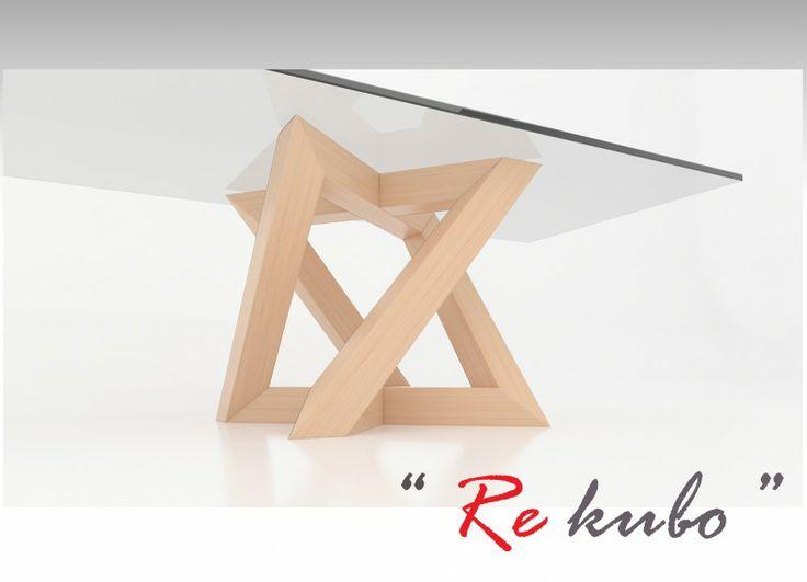 """""""Re-kubo"""" è un tavolo che ha come base di appoggio una matrice trasmutante e anamorfica, pensata in legno di massello. La sua caratteristica principale è data dalla forma della base che, attraverso l'anamorfismo di due segni, derivanti dall'intreccio dinamico delle ortogonali, creano l'energia di forze che si rincorrono e si equilibrano tra di loro, dove tutti gli elementi realizzati, verranno percepiti come una figura tridimensionale. Il piano di """"Re-kubo"""", diventa l'elemento di unione che…"""