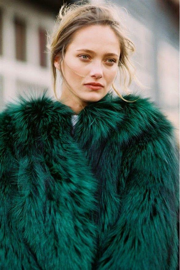 Karmen Pedaru wears an emerald green fur coat