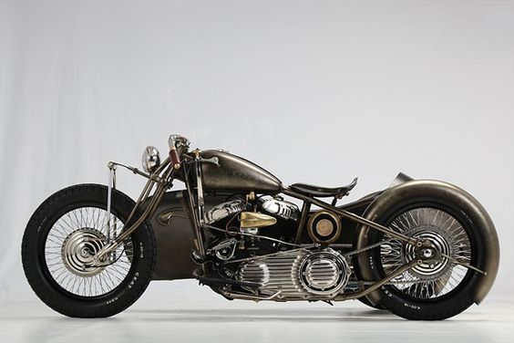 1942 Harley-Davidson Model U by Abnormal Cycle Union of Italy > The leaf spring fork is inspired by an Indian design—beefed up to cope with the extra weight—while fellow Italians Kustom Tech built the three chrome-and-brass drum brakes. The wheels are JoNich 18-inchers and the tires are from CEAT, two brands that are new names to me, but look pretty good.
