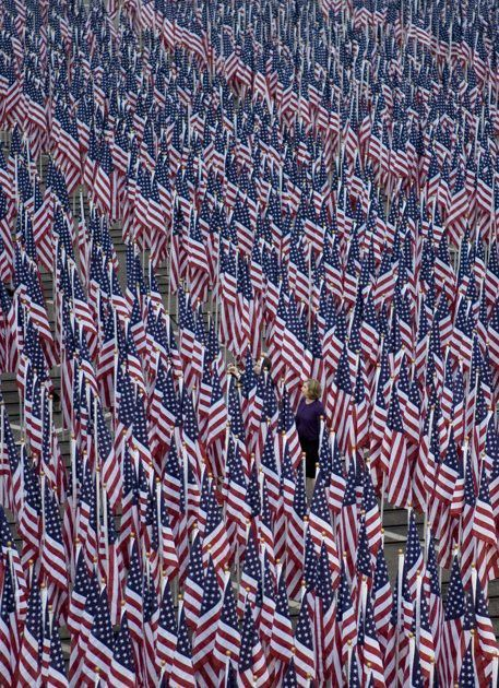 3000 flags line the Pentagon Healing Field where each flag represents a victim of the September 11 attacks, at the September 11 Pentagon Memorial Thursday, Sept. 11, 2008 at the Pentagon in Washington. (AP Photo/Evan Vucci)