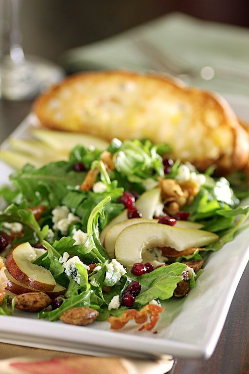 Pear Salad with arugula, cheese, almonds and port vinaigrette  http://newfinmysoup.blogspot.com/2011/10/salad-inspirations-pear-salad-with.html
