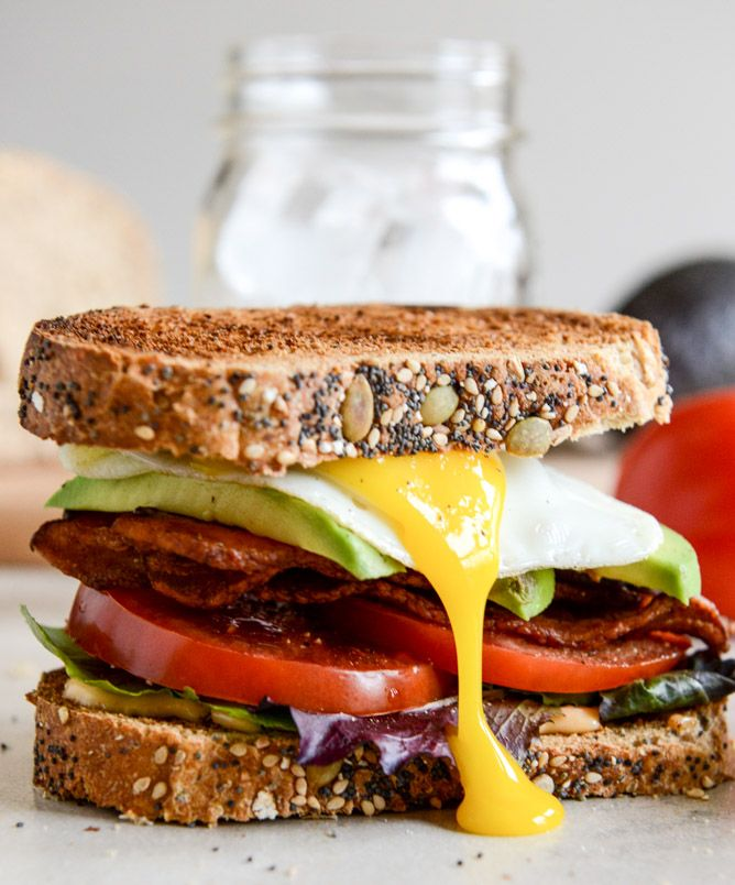 Avocado BLT with spicy mayo and fried egg.