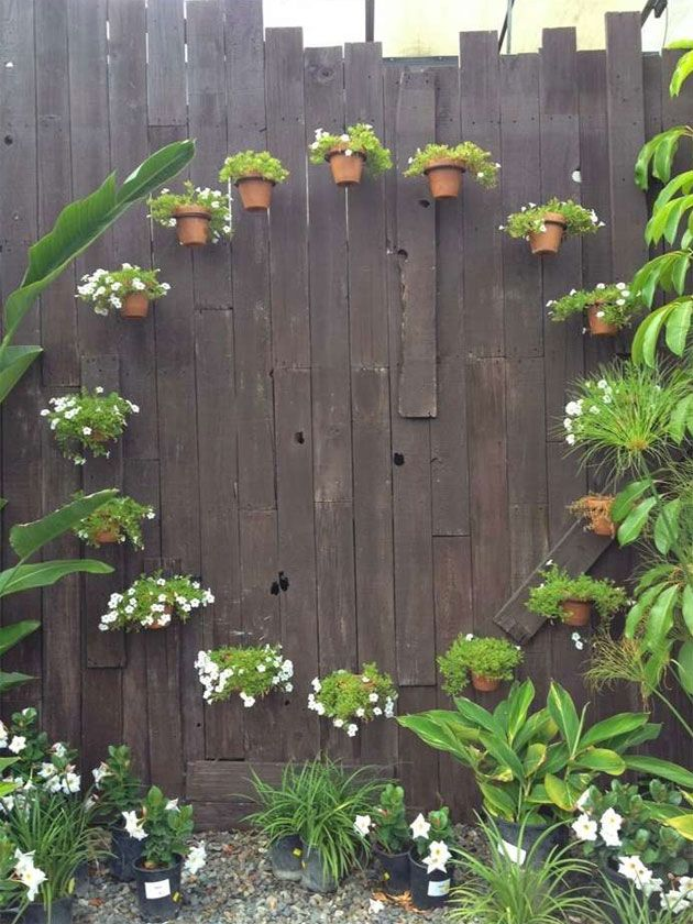 A Fairy Circle of Terracotta Pots as Garden Fence Decorations - 21 Clever Ideas To Adorn Garden And Yard With Terracotta Pots