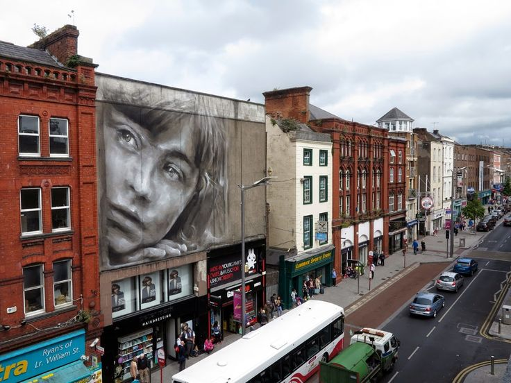 Guido Van Helten was also invited to paint for the Draw Out Street Art Festival on the streets of Limerick City in Ireland.
