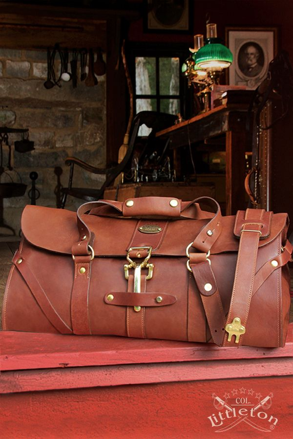 """Col. Littleton No. 1 Leather Grip Bag. If you had boarded a train from the 1870's to the 1940's, your travel bag would have been called a grip. It was a personal bag kept with you at all times. Likewise, Colonel Littleton's No. 1 Grip is designed as a carry-on-bag, not a bag to be checked. Handmade in our Col. Littleton Workshop, comes with instant """"heritage"""" as it looks as though it was inherited from your grandfather. Made in the USA."""