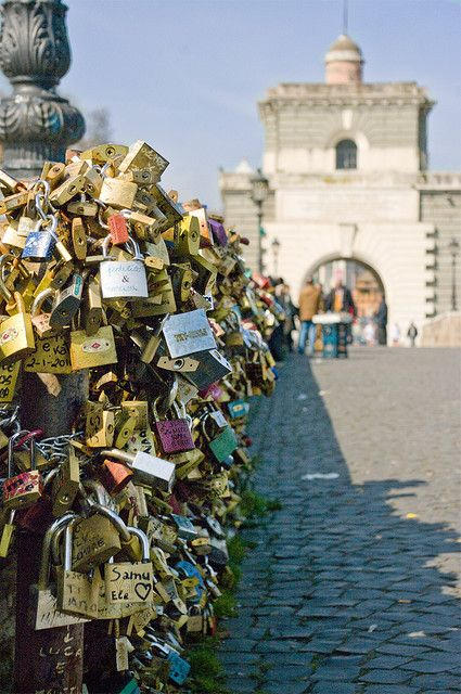 padlocks on Ponte Milvio bridge in Rome, Italy. You lock it and throw away the key in the water below