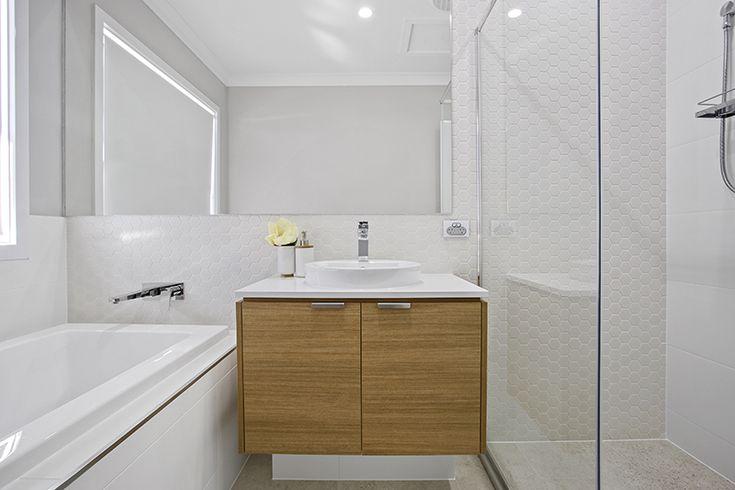 White hexagon tiles. Timber vanity. Bathroom.